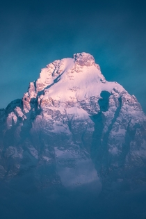 Grand Teton Peeking Through Clouds during First Light