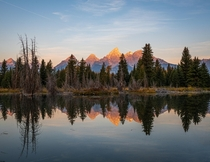 Grand Tetons USA from Schwabacher Landing Taken in October  on a morning when wildfire smoke was less prominent leaving the landscape largely devoid of haze  Instagram in comments