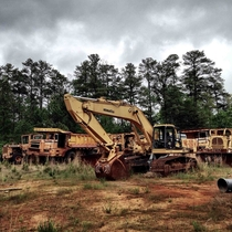 Graveyard of abandoned construction vehicles in Woodstock Georgia