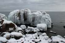 Gray Gray and more Gray Frozen rocks on Lake Superior Two Harbors MN