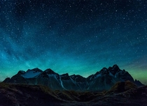 Green Airglow appearing in the night sky behind the mountains of Vestrahorn Iceland