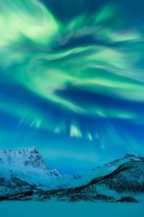 Green Flames on the Blue Sky Arctic Spring Night in Northern Norway   IGmpxmark -Story and photo info in the comments-