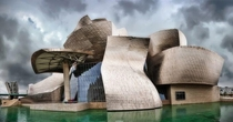 Guggenheim museum in Bilbao city of Spain is a groundbreaking modern architectural marvel The museum was officially opened in October  It was designed by famous American-Canadian architect Frank Gehry The museum features a series of interconnected buildin