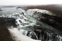 Gulfoss waterfall in Southern Iceland The river falls into a deep narrow canyon and seemingly disappears
