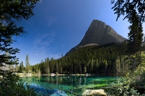 Ha Ling Peak towering over Grassi Lakes AB Canada