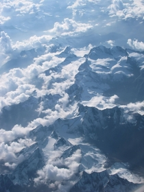 Had a very nice view of the Alps partially covered by clouds in a recent flight