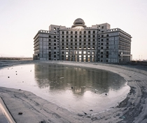 Half-constructed hotel in the development zone of Turpan city Xinjiang province China