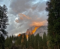 Half Dome Yosemite covered by clouds The sun shining through caused this on fire illusion