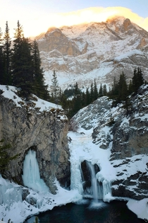 Half frozen waterfall in Kananaskis Country Canada