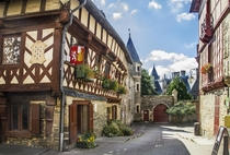 Half-timbered house and medieval castle in Josselin Morbihan France