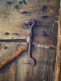 Hand hammered eye hook found in an old dairy barn