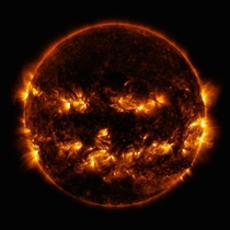 Happy Halloween Heres the Jack-o-Lantern Sun seen by the NASA Solar Dynamics Observatory Little SDO on Oct