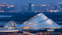 Harbin Opera House in China was designed to mirror the sinuous curves of the marsh landscape with an exterior of smooth white aluminium panels and glass