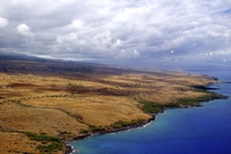 Hawaiis Big Island has one of the most diverse climates in the world  dense rainforest  desert and  volcanic rock and the top of the Mauna Kea volcano is often covered in snow Here is a picture of the Kohala desert with a rainstorm in the background