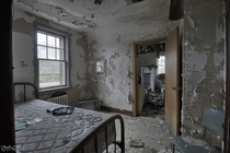 Heavily Decayed Bedroom Inside an Abandoned Time Capsule Hotel in Northern Ontario