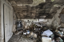 Heavily Decayed Bedroom with a Sweet Ghetto Blaster Inside an Abandoned House
