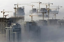 Heavy fog rolls by high-rise constructions near the Dubai Marina
