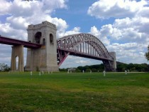 Hell Gate Bridge with cricket players Ward Island New York City