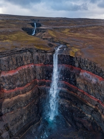 Hengifoss - waterfall with red layers in Iceland