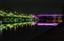 Here is a shot of the iconic landmark for Cambridge Ontario The pedestrian bridge in downtown Galt was donated a light kit rgb that changes colour once a week throughout the year The pic is oc by my sons father who would rather remain anonymous x
