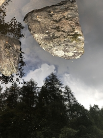 Heres a picture I took in the Lake District in the UK while on holiday with my family its the reflection in a river flipped I thought it looked pretty cool