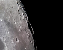 Heres an example of what is possible with a cell phone through a telescope The peak of Pythagorus Crater casting a shadow on the wall of the crater