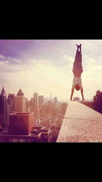 Hey reddit thought you all would find this coolinterestinginsaneridiculous A friend of mine did a handstand on a ledge of the th floor of his building yesterday with the beautiful New York skyline as a backdrop