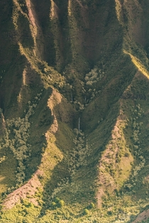Hidden waterfalls in the majestic ridges of Kalalau Valley - Kauai Hawaii