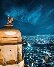 High above the city lights of Jaipur India from the turrets of Nahargarh Fort by Jacob Riglin