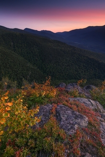 High altitude smoke and early fall leaves combined for a colorful sunset at the Imp Face ledges White Mountains NH Peak leaves are probably only  weeks away in New Hampshire