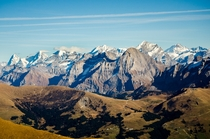 High Bernese Alps over low hills Bernese Oberland Switzerland