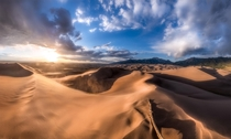 High Dune Sunset Awe-inspiring sunset at Great Sand Dunes NP in Colorado This place is truly one of a kind The tallest dunes in North America sit right next to the rugged Sangre de Cristo mountain range The natural contrast of the landscape is incredible