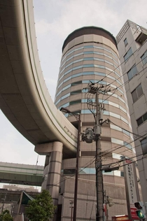 Highway offramp through a building in Osaka Japan