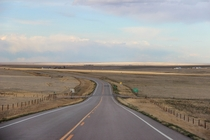 Highway  winds through the emptiness of eastern Colorado
