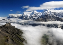 Hiked a few hours in the fog before I broke out above the clouds for this view of the Eiger Mnch and Jungfrau in Switzerland