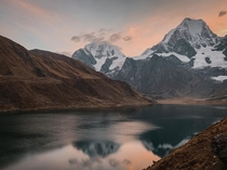 Hiked for  hours in rainy miserable conditions before setting up camp along this lake The skies cleared up just in time for sunset and we had this incredible view from our campsite Cordillera Huayhuash Peru