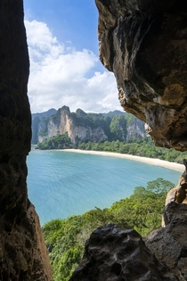 Hiked up bamboo ladders to a beautiful cave exit framing the beaches and rock formations of south Thailand