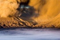 Hindu Temple Pura Luhur Poten immersed in a soft mist at the foot of the active Bromo Volcano Java