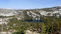 Hit the trail at the crack of noon and was treated to some of the most amazing views Ive ever seen This trail is now in my Top  Ive ever done Pictured here is one of the Ten Lakes in the Yosemite high country as seen from the descent from Ten Lakes Pass