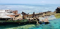 HMAS Protector an Australian gunboat built in the late th century lies off Heron Island in the Great Barrier Reef