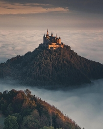 Hohenzollern Castle on a hilltop overlooking the sea of clouds in Bisingen Baden-Wrttemberg Germany
