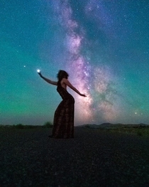 Holding Jupiter in one hand stirring up cosmic energy in the other This took quite a few tries but we got it Model  Me Long exposure galaxy shot by Photographer  Jeremiah Sorells