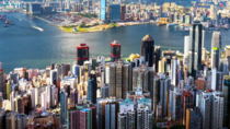 Hong Kong island and Kowloon city skyline at sunny dayHong Kong