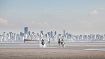 Horses racing on the beach in front of Vancouver British Columbia