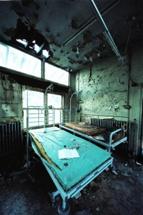 Hospital bed and peeling paint