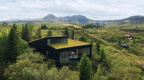 House in Iceland submerged in the forest designed by KRADS