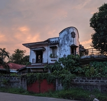 House on a moderately busy Philippine street that was abandoned during WWII and barely touched since