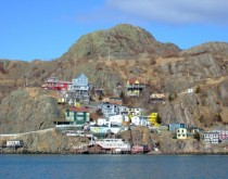 Houses of The Battery cling precariously to the rocky slope of Signal Hill part of St Johns Newfoundland The area is prone to sometimes-fatal avalanches