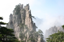 Huangshan with trees and clouds southern Anhui province in eastern China  by Arne Hckelheim
