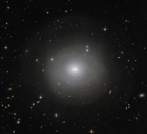 Hubble Space Telescope has captured this image of PGC  an example of a lenticular galaxy  a galaxy type that lies on the border between ellipticals and spirals